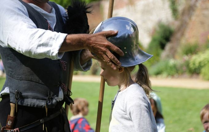 Fifi (aka Sukie the Clever) is fitted with her helmet prior to jousting