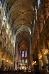 The nave view from west to east. Notre-Dame's high altar with the kneeling statues of Louis XIII and Louis XIV.