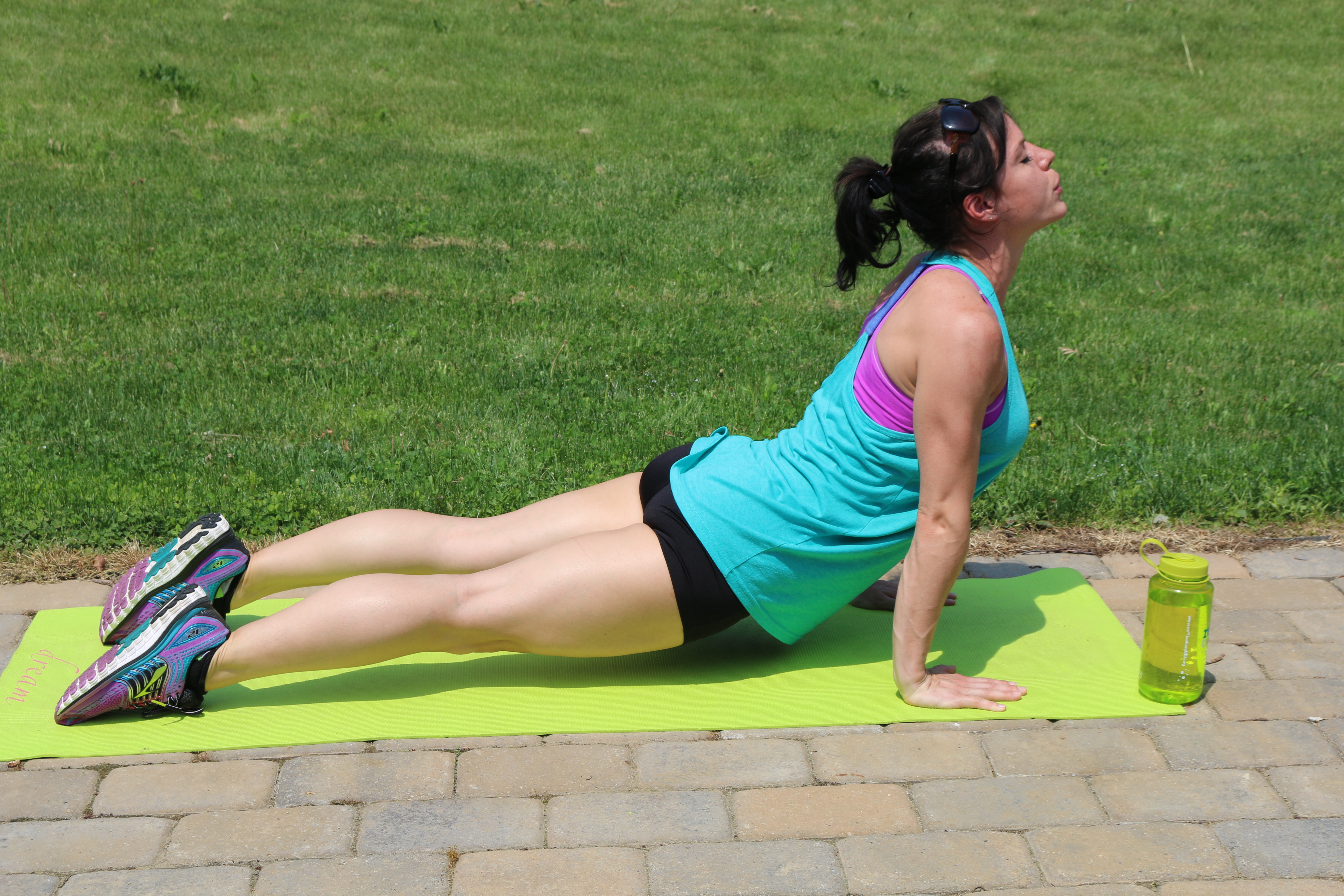 Dive Bomber: Part 3 Press the hips forward. Lift from your lower back, and com into Up Dog position.