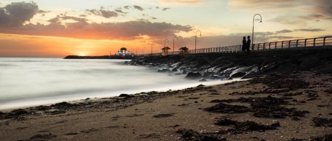 De zonsondergang, gezien vanaf het St. Kilda strand