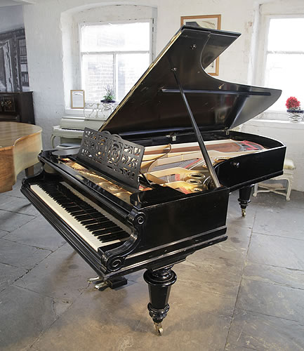 Antique, 1912, Bechstein Model E concert grand piano with a black