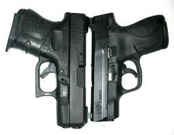 Glock 26 left, MP Shield right