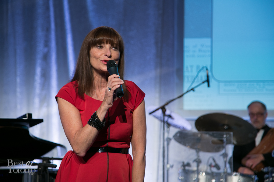 Jeanne Beker as the  auctioneer