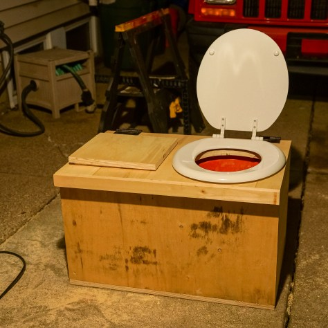 Sawdust composting toilet