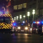 In this video grab taken Thursday July 14, 2016, ambulances and Police cars are seen after a truck drove on to the sidewalk and plowed through a crowd of revelers who'd gathered to watch the fireworks in the French resort city of Nice. Officials and eyewitnesses described as a deliberate attack. There appeared to be many casualties. (BFMTV via AP)