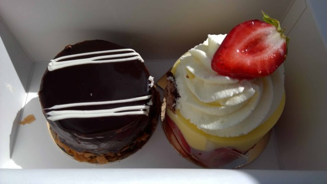 Photograph of two French patisserie cakes in a box