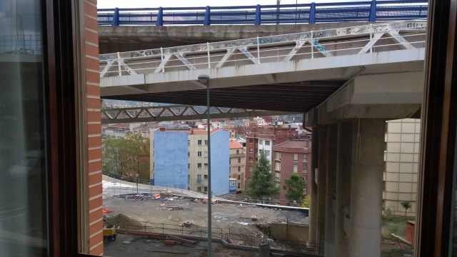 Photograph from hotel window of flyover and wasteland, Bilbao.