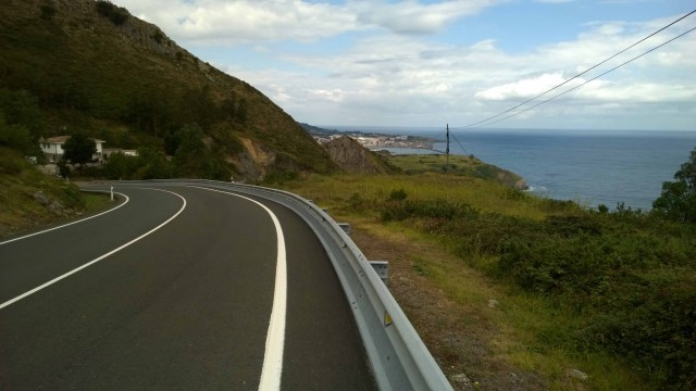 Photograph of an empty Spanish coast road snaking through the hillsides.