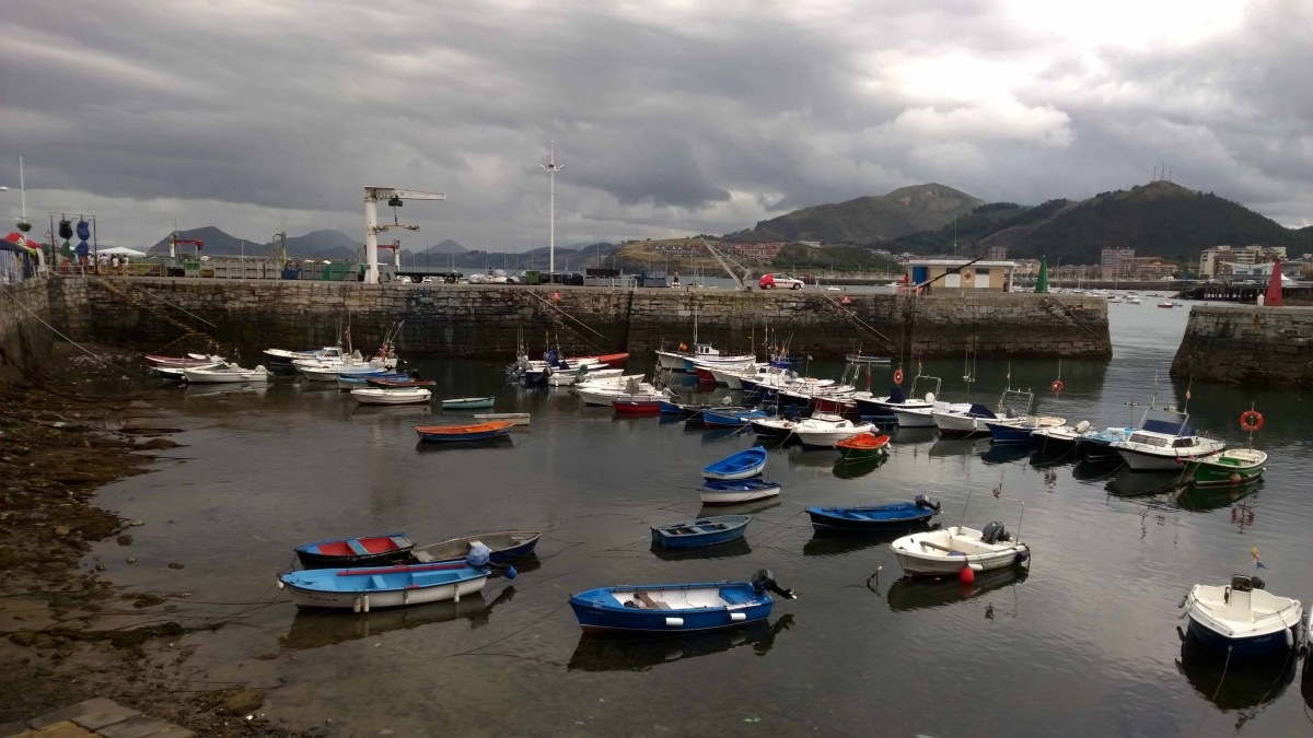 Photograph of small rowing boats in Castro Urdiales harbour.