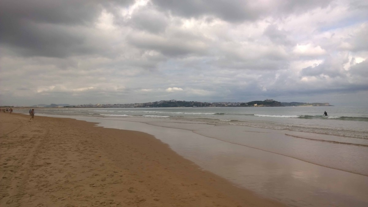 Photograph of city of Santander, Spain, in the distance across a wide river estuary.
