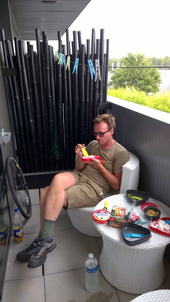 Photograph of Keith eating yogurt on hotel balcony in Arcachon, France.