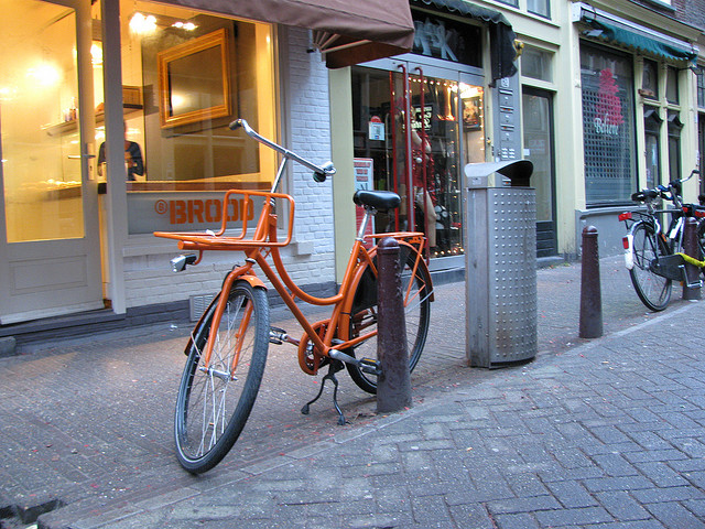 orange bike by orange storefront by Lucas Marciano via Flickr