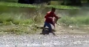 motorcyclist fights monkey