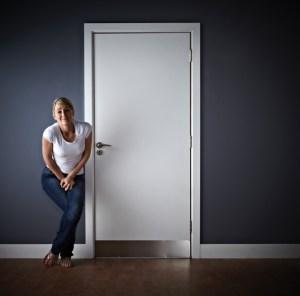 Woman waiting outside ladies toilet