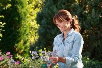 Beautiful mature woman gardening