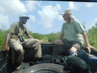 Lenn and Jeff share a light moment in the back of a truck after completing surveys (Photo by Shanna Challanger)