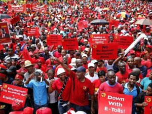 Members of South Africa's biggest union National Union of Metalworkers of South Africa (NUMSA) gather as they take part in a strike in Johannesburg, March 19, 2014. REUTERS/Siphiwe Sibeko