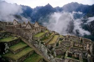Panoramic view of Machu Picchu surrounded in matinal fog Cusco1