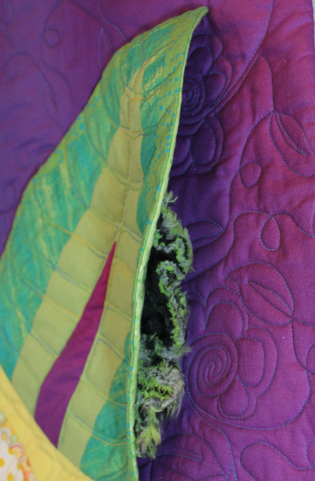 doris's caterpiller in the quilted leaves of the metamorphosis series of quilts by doris