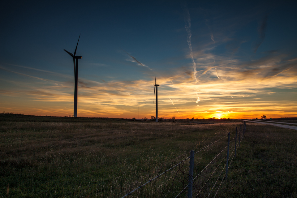 wind generators at sunset