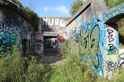 Army walls with graffiti