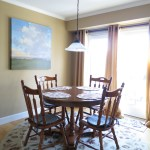 "The breakfast nook is the sunniest spot in the house, and features brand new, energy efficient Anderson ""Frenchwood"" gliding doors."