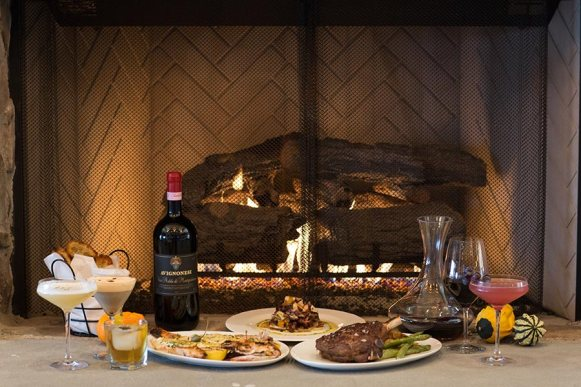 Drink and dine by our blue stone fireplace