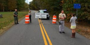 Photo Courtesy of Hawes Spencer : Police block off a large area surrounding Walnut Creek Park in Albemarle County where they say a female body was discovered Saturday afternoon - October 18, 2014.