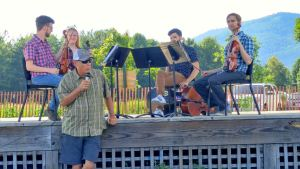 Photos courtesy of John Taylor : Steve Crandall, founder of Devils Backbone Brewing Company in Roseland, introduces The Aurelius String Quartet, this past Sunday evening - July 10, 2016. The group was performing on the stage at DBBC as part of The WPA Summer Music Festival 2016.