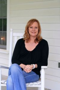 Photo By Hayley Osborne : Mary Beth McDonough sits in a rocker on the front porch of Earl Hamner's childhood home in Schuyler, Virginia in May 2011. She along with many other surviving cast members of The Waltons will be returning to Hamner's hometown in March of this year as part of the 45th reunion.