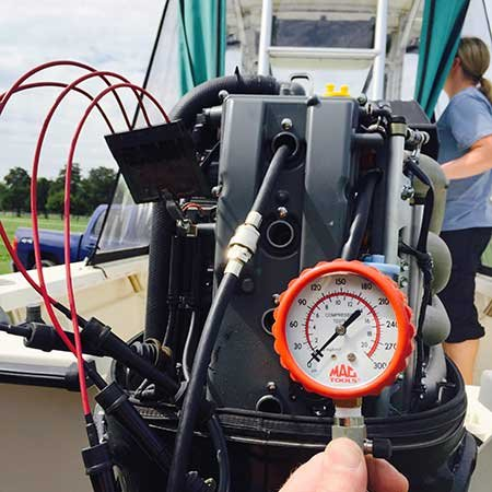 Checking Compression On An Outboard Engine - BoatUS Magazine