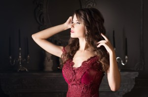 Attractive woman in long claret lace dress