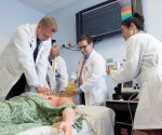 Charles E. Schmidt College of Medicine Students Nicholas Heft, Andrew Do, Bengt Grua,  Amelia Wong Learning at Simulation Center Mannequin