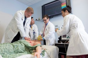 Charles E. Schmidt College of Medicine Students Nicholas Heft, Andrew Do, Bengt Grua,  Amelia Wong Learning at Simulation Center Mannequin