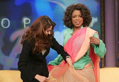 Mrs. Bachchan teaching Oprah how to sari.