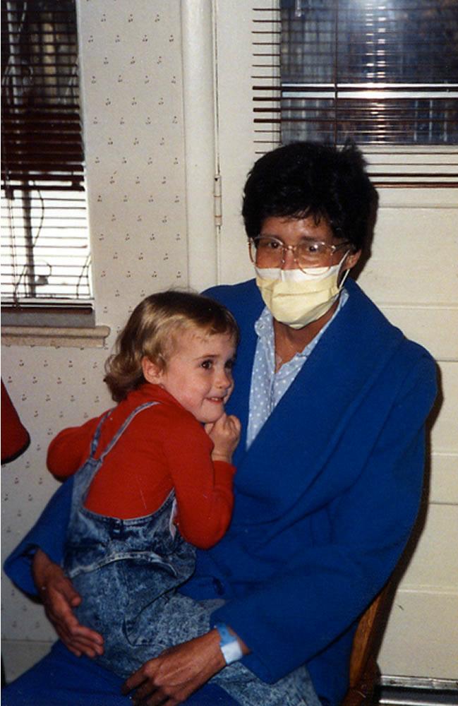 Mom snuggling in mask