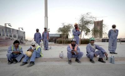 Migrant workers take a break in Qatar.