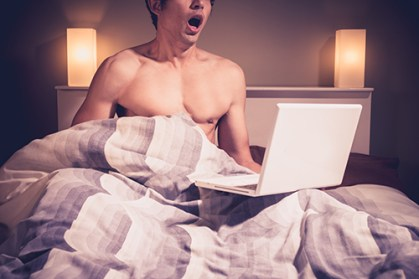 man watching porn in hotel