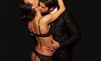 Man caressing woman in underwear