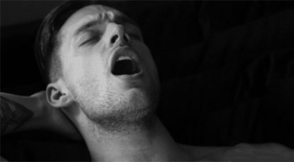 Black and white photo of a man climaxing