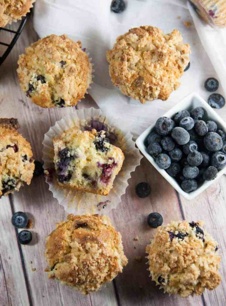 Blueberry Crumb Muffins- muffins bursting with blueberries, a hint of orange, and a crumb topping!
