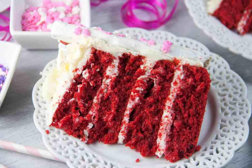 Perfect for Valentine's day! A red velvet layer cake with white chocolate cream cheese frosting decorated with chocolate covered pretzel rods!