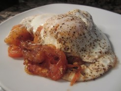 Cooked eggs and tomato