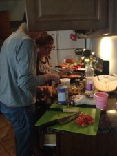 Nate and Adrienne Cooking