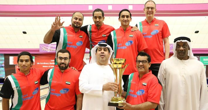 Overall Champion UAE - from left, back row, Mahmood Al Attar, Nayef Oqab Jaber, Hussain Al Suwaidi and head coach Mika Koivuniemi; front row, Khamis Al Shamsi, Sultan Al Qubaisi, Mohamed Khalifa Al Qubaisi, President of the Emirates Bowling Federation, Shaker Al Hassan and team manager Ahmed Khamis Al Ali.