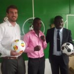 Commey and manager Amoo Bediako with Alive and Kicking Ghana chie Chris Roe