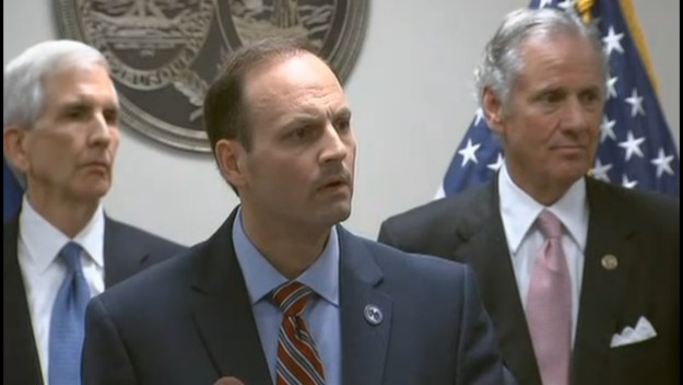 Wilson, backed by former attorneys generals Charlie Condon and Henry McMaster (Travis Medlock is off camera to the left)