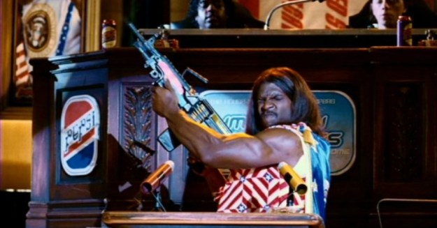 "President Dwayne Elizondo Mountain Dew Herbert Camacho, in a scene reminiscent of Ted Cruz's ""Machine-Gun Bacon"" video."
