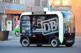 The driverless mini bus 'Olli' drives around the office grounds of Euref during a test run in the district of Schoeneberg in Berlin, Germany, 5 December 2016. The US-American compoany Local Motors wants to manufacture self-driving buses in Berlin. 50 buses are planned for the next year. Self-driving mini bus 'Olli' offers space for twelve passengers and reaches up to 20 kilometers per hour. Photo: Maurizio Gambarini/Maurizio Gambarini/dpa | Verwendung weltweit