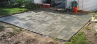 Leveling the patio ... paver by paver